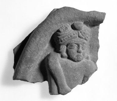 <em>Fragmentary Relief</em>, 2nd century B.C.E. Red Sandstone, 4 3/4 x 4 1/2 in. (12.1 x 11.4 cm). Brooklyn Museum, Gift of Georgia and Michael de Havenon, 80.254.1. Creative Commons-BY (Photo: Brooklyn Museum, 80.254.1_bw.jpg)