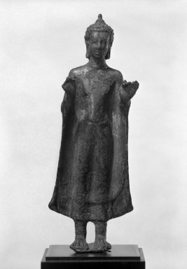 <em>Standing Buddha</em>, 7th century. Bronze with traces of gilding, 5 3/8 x 1 15/16 in. (13.7 x 5 cm). Brooklyn Museum, Gift of Harry Feinberg, 80.256. Creative Commons-BY (Photo: Brooklyn Museum, 80.256_bw.jpg)