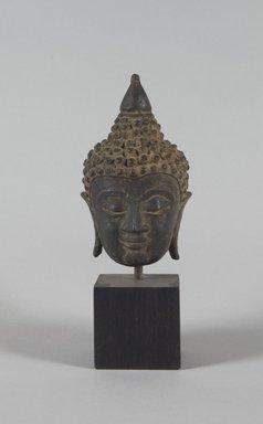 <em>Head of Buddha</em>, ca. 16th century. Bronze, 5 x 3 in. (12.7 x 7.6 cm). Brooklyn Museum, Gift of Dr. and Mrs. Eugene Halpert, 80.263.2. Creative Commons-BY (Photo: Brooklyn Museum, 80.263.2_PS5.jpg)