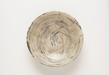 <em>Bowl</em>, last half of 15th century. Buncheong ware, stoneware with underglaze white slip decoration, Height: 1 15/16 in. (5 cm). Brooklyn Museum, Gift of John M. Lyden, 80.274.2. Creative Commons-BY (Photo: , 80.274.2_PS11.jpg)