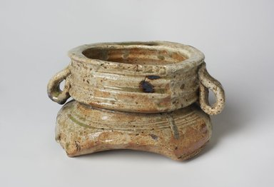 <em>Tea Ceremony Fresh Water Jar (Mizusashi)</em>, late 16th-early 17th century. Stoneware with ash glaze; Iga ware, 4 1/8 x 6 1/2 in. (10.5 x 16.5 cm). Brooklyn Museum, Gift of Mr. and Mrs. Harry Kahn, 80.42.2a-b. Creative Commons-BY (Photo: Brooklyn Museum, 80.42.2_view1_PS11.jpg)