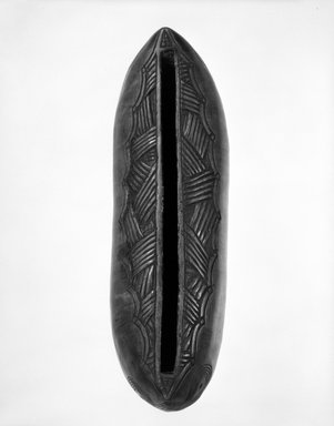Chokwe. <em>Slit Gong</em>, 20th century. Wood, 13 1/2 x 4 x 4 1/2 in. (34.3 x 10.0 x 11.0 cm). Brooklyn Museum, Carll H. de Silver Fund, 80.99. Creative Commons-BY (Photo: Brooklyn Museum, 80.99_view1_bw.jpg)