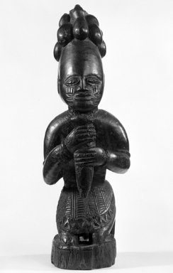 Yorùbá. <em>Kneeling Figure (Eshu-Elegba)</em>, late 19th or early 20th century. Wood, h: 11 in. (28.0 cm). Brooklyn Museum, Gift of Dr. and Mrs. Joel Hoffman, 81.102. Creative Commons-BY (Photo: Brooklyn Museum, 81.102_front_bw.jpg)