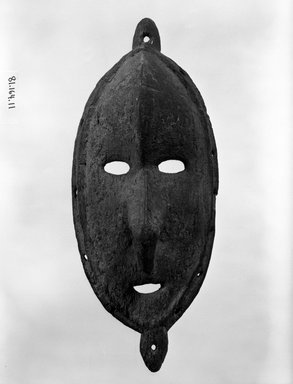 <em>Mask from a Sacred Flute</em>. Wood, 12 1/2 in. (31.8 cm). Brooklyn Museum, Gift of Mrs. Melville W. Hall, 81.164.11. Creative Commons-BY (Photo: Brooklyn Museum, 81.164.11_bw.jpg)