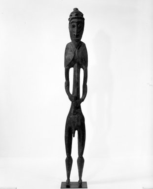<em>Male Figure</em>. Wood, pigment, H: 89 in. (226.1 cm). Brooklyn Museum, Gift of Mrs. Melville W. Hall, 81.164.14. Creative Commons-BY (Photo: Brooklyn Museum, 81.164.14_front_bw.jpg)