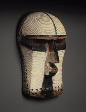 Possibly Songye. <em>Mask (Kifwebe)</em>, late 19th or early 20th century. Wood, pigments, pyro, cordage, 15 3/4 x 8 x 8 1/4 in. (40.0 x 20.0 x 21.0 cm). Brooklyn Museum, Gift of Mr. and Mrs. Bernard Leyden, 81.165. Creative Commons-BY (Photo: Brooklyn Museum, 81.165.jpg)