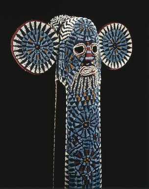 Bamileke. <em>Kuosi Society Elephant Mask</em>, 20th century. Cloth, beads, raffia, fiber, 57 3/4 x 20 1/2 x 11 1/2 in. (146.7 x 52.1 x 29.2 cm). Brooklyn Museum, Purchased with funds given by Mr. and Mrs. Milton F. Rosenthal, 81.170. Creative Commons-BY (Photo: Brooklyn Museum, 81.170_detail_SL1.jpg)