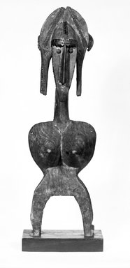 Bamana. <em>Marionette Figure Headdress</em>, late 19th-early 20th century. Wood, metal, 31 1/4 x 9 3/4 x 9 in. (79.4 x 24.8 x 22.9 cm). Brooklyn Museum, Gift of Dr. and Mrs. Robert A. Mandelbaum, 81.1. Creative Commons-BY (Photo: Brooklyn Museum, 81.1_front_bw.jpg)
