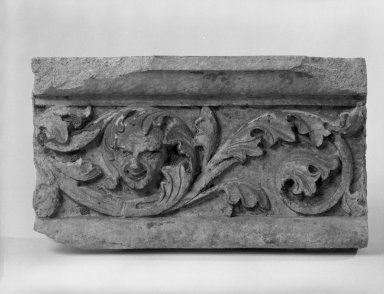 Unknown (American). <em>Foliate Border with Head, from Turner Towers, 135 Eastern Parkway, Brooklyn</em>, 1928. Cast Stone: cement composition and vitreous enamel, Other: 9 x 8 x 9 in. (22.9 x 20.3 x 22.9 cm). Brooklyn Museum, Gift of Charles Free, 81.209.10. Creative Commons-BY (Photo: Brooklyn Museum, 81.209.10_bw.jpg)