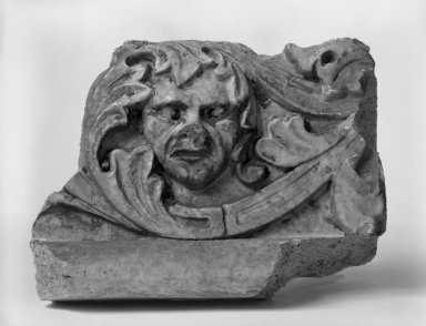 Unknown (American). <em>Foliate Border with Head, from Turner Towers, 135 Eastern Parkway, Brooklyn</em>, 1928. Cast Stone: cement composition and vitreous enamel, Other: 8 x 8 x 10 1/2 in. (20.3 x 20.3 x 26.7 cm). Brooklyn Museum, Gift of Charles Free, 81.209.11. Creative Commons-BY (Photo: Brooklyn Museum, 81.209.11_bw.jpg)
