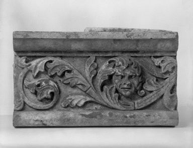 Unknown (American). <em>Foliate Border with Head, from Turner Towers, 135 Eastern Parkway, Brooklyn</em>, 1928. Cast Stone: cement composition and vitreous enamel, Other: 7 3/4 x 13 1/2 x 5 in. (19.7 x 34.3 x 12.7 cm). Brooklyn Museum, Gift of Charles Free, 81.209.9. Creative Commons-BY (Photo: Brooklyn Museum, 81.209.9_bw.jpg)
