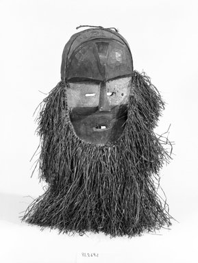 Ambete. <em>Mask</em>, late 19th-early 20th century. Wood, pigment, raffia, 17 3/4 x 11 x 4 1/4 in. (45.0 x 29.0 x 10.9 cm). Brooklyn Museum, Gift of Mr. and Mrs. Joseph Gerofsky, 81.269.1. Creative Commons-BY (Photo: Brooklyn Museum, 81.269.1_bw.jpg)