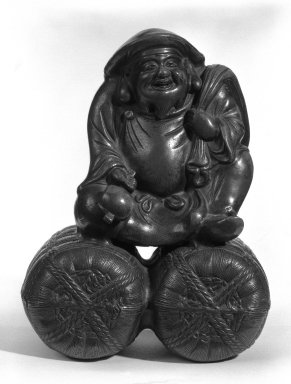 <em>Figure of Daikoku</em>, 19th century. Bizen ware, 9 3/4 x 7 1/2 in. (24.8 x 19.1 cm). Brooklyn Museum, Gift of Dr. John P. Lyden, 81.296.3. Creative Commons-BY (Photo: Brooklyn Museum, 81.296.3_bw.jpg)