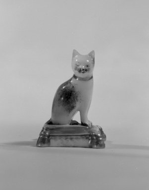 <em>Figure of a Cat</em>, ca. 1826-1830. Porcelain, 1 1/2 x 1 1/8 x 1 1/8 in. (3.8 x 2.9 x 2.9 cm). Brooklyn Museum, Bequest of Dr. Grace McLean Abbate, 81.53.10. Creative Commons-BY (Photo: Brooklyn Museum, 81.53.10_cropped_bw.jpg)