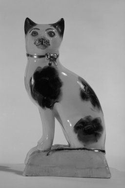 <em>Figure of a Cat</em>, ca. 1960. Lead-glazed earthenware, 3 3/4 x 2 1/4 x 1 3/4 in. (9.5 x 5.7 x 4.4 cm). Brooklyn Museum, Bequest of Dr. Grace McLean Abbate, 81.53.12. Creative Commons-BY (Photo: Brooklyn Museum, 81.53.12_bw.jpg)