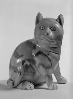 <em>Figure of a Cat</em>, late 18th-early 19th century. Porcelain, 5 1/4 x 4 x 3 3/4 in. (13.3 x 10.2 x 9.5 cm). Brooklyn Museum, Bequest of Dr. Grace McLean Abbate, 81.53.14. Creative Commons-BY (Photo: Brooklyn Museum, 81.53.14_bw.jpg)