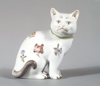 <em>Figure of a Cat</em>, possibly 19th century (body); 20th century (decoration). Hard-paste porcelain, 5 1/4 x 5 x 3 1/2 in. (13.3 x 12.7 x 8.9 cm). Brooklyn Museum, Bequest of Dr. Grace McLean Abbate, 81.53.17. Creative Commons-BY (Photo: Brooklyn Museum, 81.53.17_transp2736.jpg)