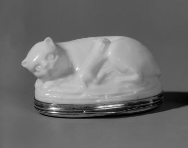 <em>Bonbonnière in Form of a Cat</em>, mid 18th century. Porcelain, silver, 1 1/8 x 2 1/4 x 1 5/8 in. (2.9 x 5.7 x 4.1 cm). Brooklyn Museum, Bequest of Dr. Grace McLean Abbate, 81.53.1. Creative Commons-BY (Photo: Brooklyn Museum, 81.53.1_cropped_bw.jpg)
