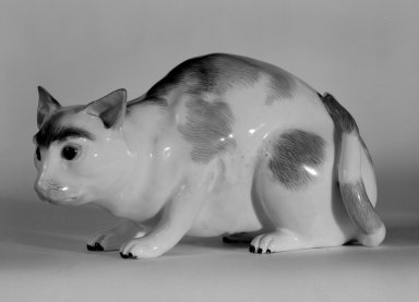 Meissen Porcelain Factory (German, founded 1710). <em>Figure of a Cat</em>, ca. 1890. Hard-paste porcelain, 3 x 6 x 3 in. (7.6 x 15.2 x 7.6 cm). Brooklyn Museum, Bequest of Dr. Grace McLean Abbate, 81.53.4. Creative Commons-BY (Photo: Brooklyn Museum, 81.53.4_bw.jpg)