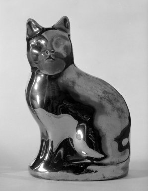<em>Bank in Form of a Cat</em>, ca. 1810. Lustreware, 4 1/2 x 2 3/4 x 1 3/4 in. (11.4 x 7 x 4.4 cm). Brooklyn Museum, Bequest of Dr. Grace McLean Abbate, 81.53.8. Creative Commons-BY (Photo: Brooklyn Museum, 81.53.8_cropped_bw.jpg)