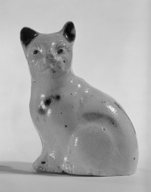<em>Figure of a Cat</em>, ca. 1800. Salt-glazed stoneware, 3 1/4 x 2 1/2 x 1 7/8 in. (8.3 x 6.4 x 4.8 cm). Brooklyn Museum, Bequest of Dr. Grace McLean Abbate, 81.53.9. Creative Commons-BY (Photo: Brooklyn Museum, 81.53.9_cropped_bw.jpg)