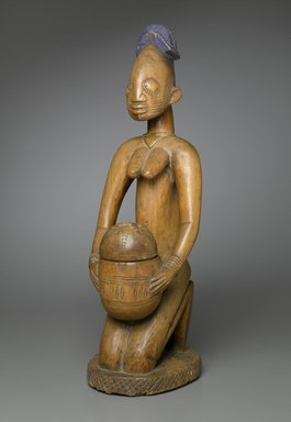 Possibly Maku, master carver of Erin (died 1915). <em>Kneeling Female Figure (Arugba)</em>, early 20th century. Wood, pigment, 22 x 7 x 8 in. (55.9 x 17.8 x 20.3 cm). Brooklyn Museum, Gift of Dr. and Mrs. Robert A. Mandelbaum, 82.103a-b. Creative Commons-BY (Photo: Brooklyn Museum, 82.103a-b_PS2.jpg)