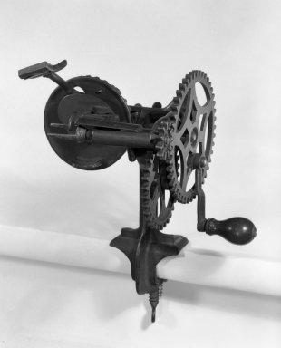 American. <em>Apple Peeler</em>, 19th century. Iron, wood, 10 3/4 x 8 x 6 1/2 in. (27.3 x 20.3 x 16.5 cm). Brooklyn Museum, Gift of Fred Tannery, 82.112.10a-b. Creative Commons-BY (Photo: Brooklyn Museum, 82.112.10a-b_bw.jpg)