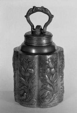 <em>Canister with Lid</em>, 17th-18th century. Pewter, 6 3/8 x 4 1/4 in. (16.2 x 10.8 cm). Brooklyn Museum, Gift of Fred Tannery, 82.112.11a-b. Creative Commons-BY (Photo: Brooklyn Museum, 82.112.11a-b_bw.jpg)