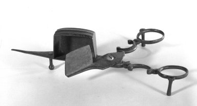 American. <em>Candle-snuffer</em>, early 19th century. Iron, 2 3/8 x 7 1/4 in. (6 x 18.4 cm). Brooklyn Museum, Gift of Fred Tannery, 82.112.6. Creative Commons-BY (Photo: Brooklyn Museum, 82.112.6_bw.jpg)