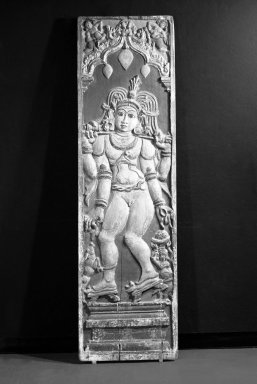 <em>Shiva as Youth</em>, 17th-18th century. Polychromed wood relief panel, 81 1/2 x 23 1/4 in. Brooklyn Museum, Gift of Dr. Andrew Dahl, 82.118.3. Creative Commons-BY (Photo: Brooklyn Museum, 82.118.3_bw.jpg)