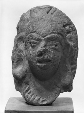 <em>Head of a Female Deity</em>, 3rd-4th century. Terracotta, 4 1/2 in. (11.4 cm). Brooklyn Museum, Gift of Dr. and Mrs. James R. Miller, 82.123. Creative Commons-BY (Photo: Brooklyn Museum, 82.123_bw.jpg)