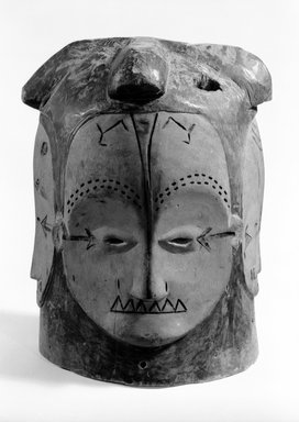 Fang. <em>Helmet Mask (Ñgontang) with Four Faces</em>, late 19th-early 20th century. Wood, pigments, 11 x 7 1/4 x 7 1/4 in. (28.0 x 10.5 x 18.5 cm). Brooklyn Museum, Anonymous gift, 82.157. Creative Commons-BY (Photo: Brooklyn Museum, 82.157_view1_bw.jpg)