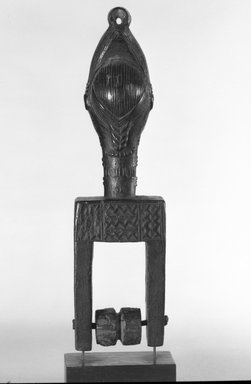 Baule. <em>Heddle Pulley with Female Head</em>, late 19th or early 20th century. Wood, 8 1/8 x 2 1/8 x 1 7/8 in.  (20.6 x 5.4 x 4.8 cm). Brooklyn Museum, Gift of Dr. Henry Fischer, Jr., 82.213.1. Creative Commons-BY (Photo: Brooklyn Museum, 82.213.1_bw.jpg)