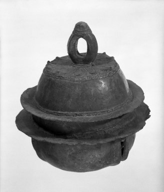 <em>Bell</em>, 12th-13th century. Bronze, 6 3/4 x 5 1/2 in. (17.1 x 14 cm). Brooklyn Museum, Gift of Dr. Fred S. Hurst, 82.223.3. Creative Commons-BY (Photo: Brooklyn Museum, 82.223.3_bw.jpg)