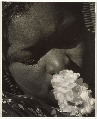 Consuelo Kanaga (American, 1894-1978). <em>Frances with a Flower</em>, early 1930s. Gelatin silver photograph, Image: 10 5/8 x 8 in. (27 x 20.3 cm). Brooklyn Museum, Gift of Wallace B. Putnam from the Estate of Consuelo Kanaga, 82.65.10 (Photo: Brooklyn Museum, 82.65.10_SL1_edited.jpg)