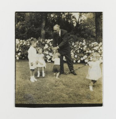 Consuelo Kanaga (American, 1894-1978). <em>[Untitled] (Man with Four Children)</em>. Gelatin silver photograph, 2 1/4 x 2 1/4 in. (5.7 x 5.7 cm). Brooklyn Museum, Gift of Wallace B. Putnam from the Estate of Consuelo Kanaga, 82.65.150 (Photo: Brooklyn Museum, 82.65.150_PS2.jpg)