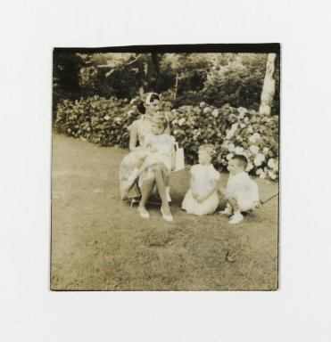 Consuelo Kanaga (American, 1894-1978). <em>[Untitled] (Woman with Three Children in Garden)</em>. Gelatin silver photograph, 2 1/4 x 2 1/4 in. (5.7 x 5.7 cm). Brooklyn Museum, Gift of Wallace B. Putnam from the Estate of Consuelo Kanaga, 82.65.151 (Photo: Brooklyn Museum, 82.65.151_PS2.jpg)