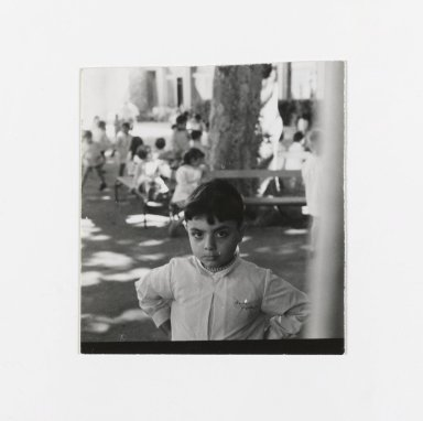 Consuelo Kanaga (American, 1894-1978). <em>[Untitled] (Young Boy, other Children and Benches in Background)</em>. Gelatin silver photograph, 2 3/8 x 2 1/8 in. (6 x 5.4 cm). Brooklyn Museum, Gift of Wallace B. Putnam from the Estate of Consuelo Kanaga, 82.65.190 (Photo: Brooklyn Museum, 82.65.190_PS2.jpg)