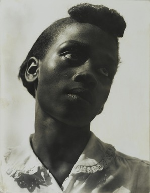 Consuelo Kanaga (American, 1894-1978). <em>[Untitled] (Portrait of a Young Girl)</em>, late 1940s. Gelatin silver photograph, 9 3/4 x 7 1/2 in. (24.8 x 19.1 cm). Brooklyn Museum, Gift of Wallace B. Putnam from the Estate of Consuelo Kanaga, 82.65.1 (Photo: Brooklyn Museum, 82.65.1_PS2_edited.jpg)