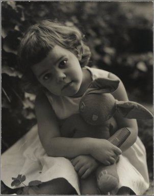 Consuelo Kanaga (American, 1894-1978). <em>[Untitled] (Girl with Stuffed Rabbit)</em>. Gelatin silver photograph, 9 5/8 x 7 5/8 in. (24.4 x 19.4 cm). Brooklyn Museum, Gift of Wallace B. Putnam from the Estate of Consuelo Kanaga, 82.65.20 (Photo: Brooklyn Museum, 82.65.20_PS2.jpg)