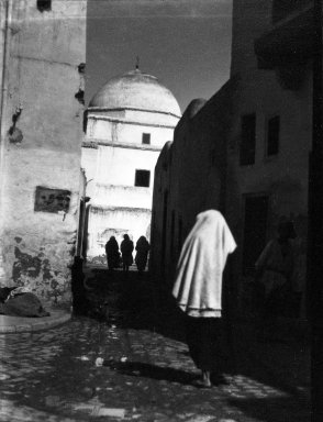 Consuelo Kanaga (American, 1894-1978). <em>[Untitled] (Women on a Street, Kairouan, North Africa)</em>, 1928. Negative, Negative: 3 1/16 x 4 1/8 in. (7.8 x 10.5 cm). Brooklyn Museum, Gift of Wallace B. Putnam from the Estate of Consuelo Kanaga, 82.65.2138 (Photo: Brooklyn Museum, 82.65.2138_bw_IMLS.jpg)