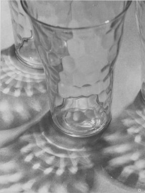 Consuelo Kanaga (American, 1894-1978). <em>Glasses and Reflections</em>, 1948. Gelatin silver photograph, 4 3/4 x 3 5/8 in. (12.1 x 9.2 cm). Brooklyn Museum, Gift of Wallace B. Putnam from the Estate of Consuelo Kanaga, 82.65.24 (Photo: Brooklyn Museum, 82.65.24_PS2.jpg)