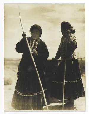 Consuelo Kanaga (American, 1894-1978). <em>[Untitled] (Native American Women with Wooden Poles, New Mexico)</em>, 1950s. Gelatin silver photograph, 3 3/4 x 2 7/8 in. (9.5 x 7.3 cm). Brooklyn Museum, Gift of Wallace B. Putnam from the Estate of Consuelo Kanaga, 82.65.253 (Photo: Brooklyn Museum, 82.65.253_PS2.jpg)