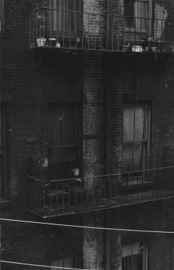 Consuelo Kanaga (American, 1894-1978). <em>[Untitled] (Tenement, Child on Fire Escape)</em>. Gelatin silver photograph, 9 1/2 x 6 1/8 in. (24.1 x 15.6 cm). Brooklyn Museum, Gift of Wallace B. Putnam from the Estate of Consuelo Kanaga, 82.65.314 (Photo: Brooklyn Museum, 82.65.314_PS2.jpg)