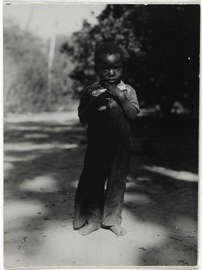Consuelo Kanaga (American, 1894-1978). <em>[Untitled] (Boy with Gun)</em>, 1948-1950. Gelatin silver photograph, 3 15/16 x 2 7/8 in. (10 x 7.3 cm). Brooklyn Museum, Gift of Wallace B. Putnam from the Estate of Consuelo Kanaga, 82.65.34 (Photo: Brooklyn Museum, 82.65.34_PS2.jpg)