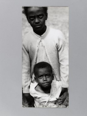 Consuelo Kanaga (American, 1894-1978). <em>[Untitled] (Two Children in Tennessee)</em>, late 1940s. Gelatin silver photograph, 13 1/4 x 6 1/4 in. (33.7 x 15.9 cm). Brooklyn Museum, Gift of Wallace B. Putnam from the Estate of Consuelo Kanaga, 82.65.393 (Photo: Brooklyn Museum, 82.65.393_PS1.jpg)