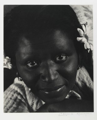 Consuelo Kanaga (American, 1894-1978). <em>[Untitled] (Woman with Daisies)</em>. Gelatin silver photograph, Image: 10 5/8 x 8 7/8 in. (27 x 22.5 cm). Brooklyn Museum, Gift of Wallace B. Putnam from the Estate of Consuelo Kanaga, 82.65.402 (Photo: Brooklyn Museum, 82.65.402_PS2.jpg)