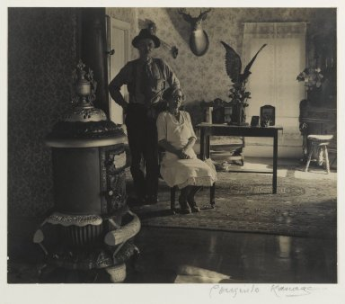 Consuelo Kanaga (American, 1894-1978). <em>Mr. and Mrs. Stanley, The Adirondacks (The Front Parlor)</em>, 1936. Toned gelatin silver photograph with graphite, 7 1/4 x 8 5/8 in. (18.4 x 21.9 cm). Brooklyn Museum, Gift of Wallace B. Putnam from the Estate of Consuelo Kanaga, 82.65.406 (Photo: Brooklyn Museum, 82.65.406_PS2.jpg)