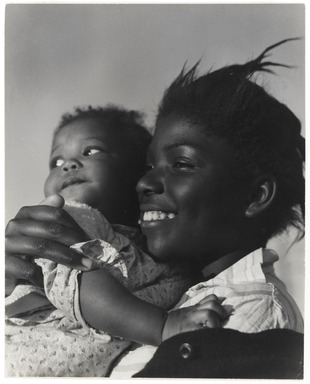 Consuelo Kanaga (American, 1894-1978). <em>[Untitled] (Young Mother with Baby Girl, Florida)</em>, 1950. Gelatin silver photograph, 9 3/4 x 7 3/4 in. (24.8 x 19.7 cm). Brooklyn Museum, Gift of Wallace B. Putnam from the Estate of Consuelo Kanaga, 82.65.455 (Photo: Brooklyn Museum, 82.65.455_PS2.jpg)