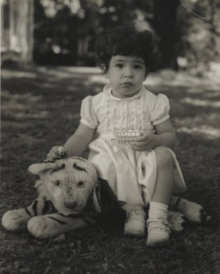 Consuelo Kanaga (American, 1894-1978). <em>[Untitled] (Child Sitting on Stuffed Tiger)</em>. Gelatin silver photograph, 4 3/4 x 3 7/8 in. (12.1 x 9.8 cm). Brooklyn Museum, Gift of Wallace B. Putnam from the Estate of Consuelo Kanaga, 82.65.60 (Photo: Brooklyn Museum, 82.65.60_PS2.jpg)